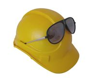 Yellow Hat with safety glasses. Eye protection Royalty Free Stock Image