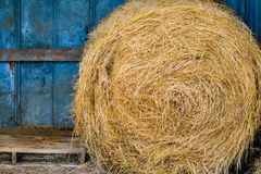 Yellow Hay Bale in Blue Shed Royalty Free Stock Photography