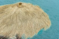 Hay roof with sea Royalty Free Stock Photo