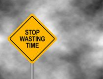 Yellow hazard roadsign with STOP WASTING TIME message. Bord isolated on a grey sky background. Vector illustration. Yellow hazard roadsign with STOP WASTING Royalty Free Stock Photo