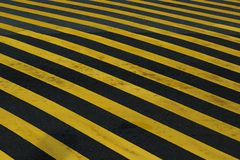 Yellow hazard stripe texture background for the floor. Striped black and yellow grunge background, warning signage royalty free stock image