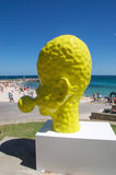 Yellow Head Sculpture: Blowing Bubble in Profile Royalty Free Stock Photos