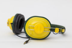 Yellow headphones on white background Royalty Free Stock Photography