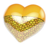 Yellow heart shaped pill, capsule filled with small tiny hearts as medicine Stock Photo