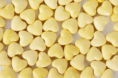 Yellow heart shaped pills. Background - studio shoot, top view Royalty Free Stock Images