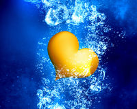 Yellow heart under water. Yellow love heart under clear blue water stock illustration