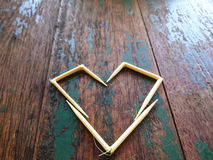 Yellow heart on the wooden table Royalty Free Stock Image