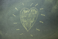 Yellow hearts on chalkboard background. Royalty Free Stock Photography