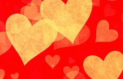 Yellow hearts on red backgrounds Royalty Free Stock Photos