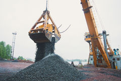 Yellow heavy excavator and bulldozer excavating sand and working during road works, unloading sand and road metal Stock Images
