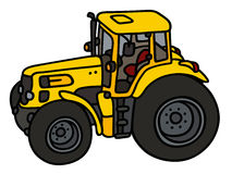 Yellow heavy tractor Royalty Free Stock Images
