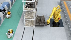 Yellow heavyweight robotic arm carrying vehicles seats for assembly