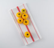Yellow Heirloom Tomatoes on French Towel Stock Photo