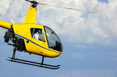 Yellow helicopter Stock Image