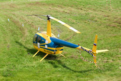 Yellow helicopter in the international competitions on helicopter sports Stock Image