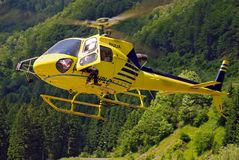 Yellow helicopter landing on Carnic Alps Royalty Free Stock Photo