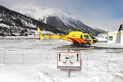 A yellow helicopter in the snowy alps switzerland in winter.  royalty free stock photos