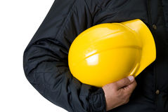 Yellow helmet. At man hands isolatedn white Stock Photography