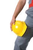Yellow helmet. At man hands isolated on a white Stock Images