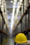 Yellow Helmet. Yellow safety helmet in the warehouse stock photos