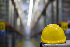 Yellow Helmet. Yellow safety helmet in the warehouse stock photo