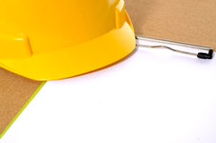 Yellow Helmet And Clipboard Royalty Free Stock Photo