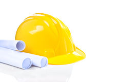 Yellow helmet with blueprints isolated Stock Images