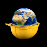Yellow helmet with earth planet Stock Image