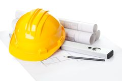 Yellow helmet on house project construction plan Royalty Free Stock Images
