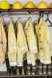 Yellow helmet and jacket of fire fighter Stock Images