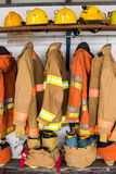 Yellow helmet and jacket of fire fighter Stock Photos