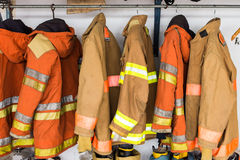 Yellow helmet and jacket of fire fighter Royalty Free Stock Images