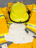 Yellow helmet and jacket of firefighter Stock Photo