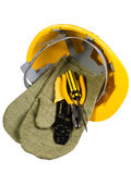 Yellow helmet, mittens, instrument Royalty Free Stock Photography