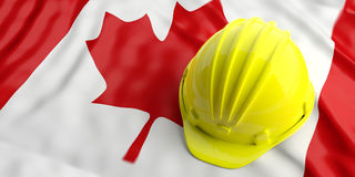 Yellow helmet over Canada flag. 3d illustration Stock Image