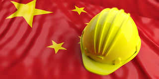 Yellow helmet over China flag. 3d illustration Royalty Free Stock Photography