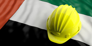 Yellow helmet over United Arab Emirates flag. 3d illustration. Yellow construction hat over UAE  flag. 3d illustration Stock Images