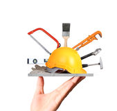 Yellow helmet plastic safety and tools in hand Royalty Free Stock Images