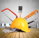 Yellow helmet plastic safety and tools Royalty Free Stock Image