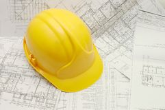 Yellow helmet on project Stock Photography
