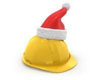 Yellow helmet with santa claus hat on top Royalty Free Stock Photo