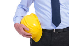 Yellow helmet at waist of business man Stock Photos