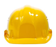 Yellow helmet on white. Yellow helmet isolated on white. Clipping path included Stock Images
