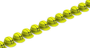 Yellow helmets lined up in rows Stock Photography