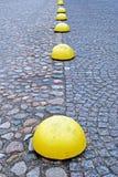 Yellow hemisphere limiters Stock Image