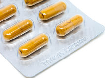 Yellow herb pills transparent gelatin capsule in blister pack Royalty Free Stock Images