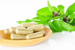 Yellow herbal capsule medicine drug. Royalty Free Stock Photo