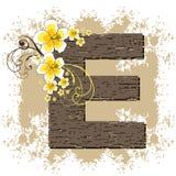 Yellow hibiscus alphabet E. Yellow hibiscus grunge vintage alphabet E Royalty Free Stock Photography