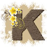 Yellow hibiscus alphabet K. Yellow hibiscus grunge vintage alphabet K Royalty Free Stock Photos
