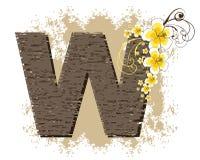 Yellow hibiscus alphabet W. Yellow hibiscus grunge vintage alphabet W Royalty Free Stock Photos
